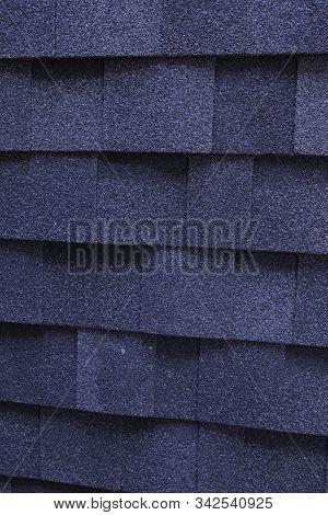 Asphalt Shingles Photo. Dark Blue Roofing Shingles Texture Background. Asphalt  Roof Shingles Textur