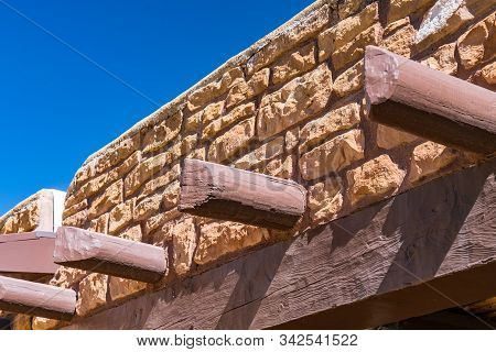 Vigas Protruding From Old Southwestern Stone Building