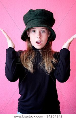 Beautiful young model in hat on the  pink background