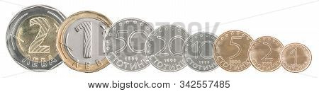A Complete Set Of Bulgarian Coins Stand In A Row One After Another. Isolated Over White Background.