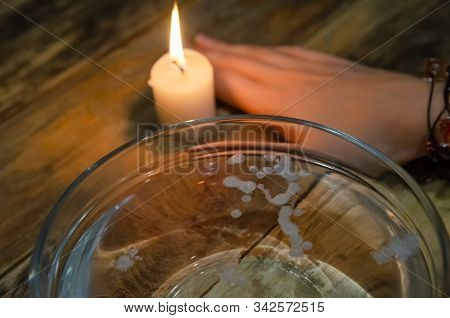 Divination With A Candle On The Water. Concept Of Magic, Divination