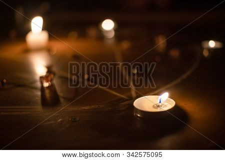 Pentagram Is Painted On The Floor, Candles Are Lit, Beads Are Lying, Shells Are Scattered. Concept O