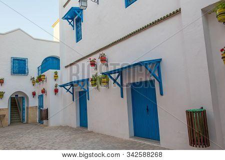 Yasmine Hammamet, Tunisia - July 26 2018: White House With Blue Windows And Doors And Flowers, Yasmi