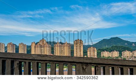 Highrise Residential And Commercial Buildings On The Shore Of Yangtze River In Chongqing City, China