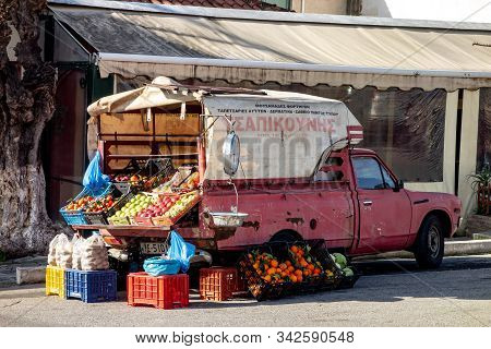 Patras, Greece - February 7, 2019:  The Typical Old Red Retro Rusty Datsun 1500 Pickup Car Of A Loca