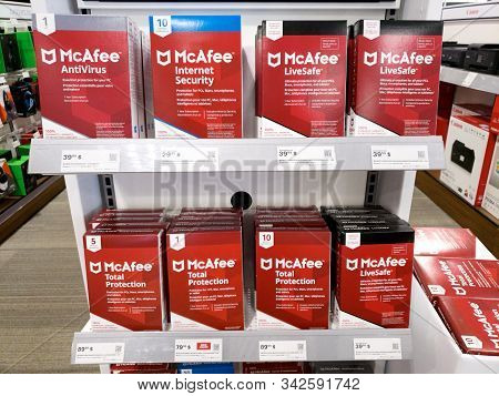 Montreal, Canada - December 26, 2019: Mcafee Products On Shelves In Store. Mcafee Is An American Glo