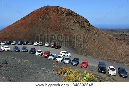 Yaiza, Lanzarote, Spain - March 28, 2019:     Cars  Parked  In Volcanic Landscape Of Lanzarote.