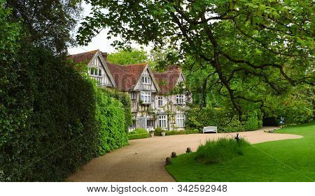 Ticehurst, East Sussex, England - May 18, 2019: The Tudor Front And Drive Way Of Pashley Manor East