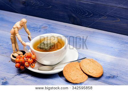 Health Care Folk Remedies. Cup Of Tea On Blue Background Close Up. Gourmet Delicious Taste. Cafe Men