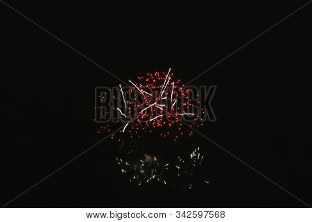 Inexpensive Fireworks, Over The Black City Sky, Red And Pink. Light Flares. For Any Purpose