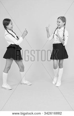 School Application Smartphone. School Girls Use Smartphone To Take Photo. Girls School Uniform. Pers