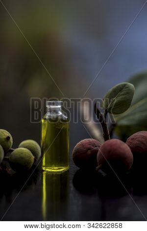 Close Up Shot Of Extracted Herbal Floral And Beneficial Banyan Tree Essence In A Tiny Glass Bottle O
