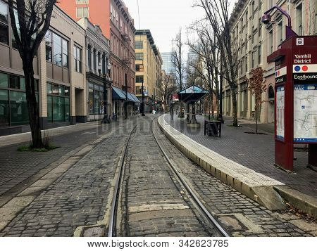 Portland, Oregon - December 29th, 2019: An Empty Downtown Street Looking Straight Down The Trolley T