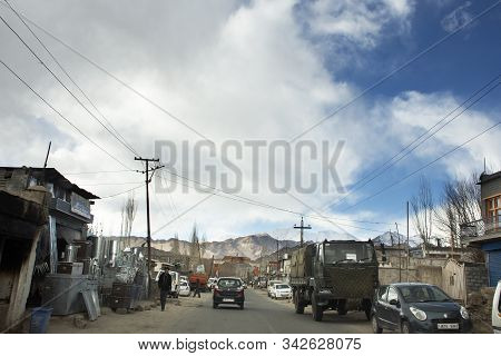 Traffic Road And Indian People Drive Car And Riding Motorcycle And Walking On Leh Manali Highway At