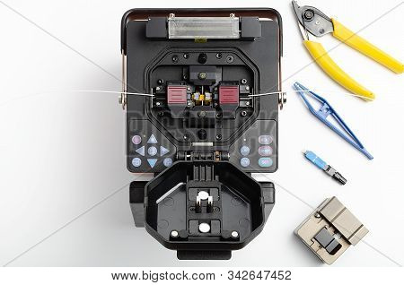 Welding Machine And Tool Kit For Stripping And Welding Of Optical Fiber
