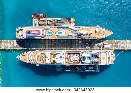 Aerial View Of Two Giant Cruise Ships Moored In The Port Of Philipsburg Along With Three Barges, Isl