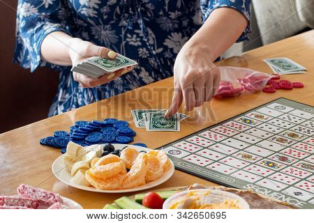 Sydney, Australia 2019-12-04 Friends Ready To Play Sequence Board Game On A Wooden Table With Color