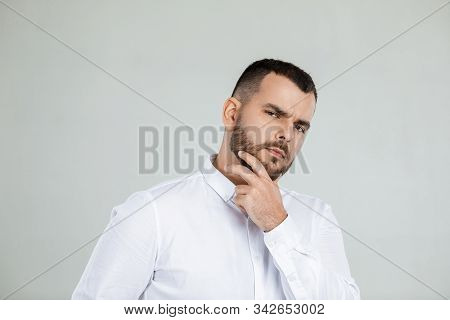 Doubtful Bearded Man Thinking About Something On Gray Background.