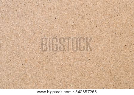 Light Brown Wrapping Paper. Natural Sheet Surface, Packaging Background. Texture Of Cardboard, Paste