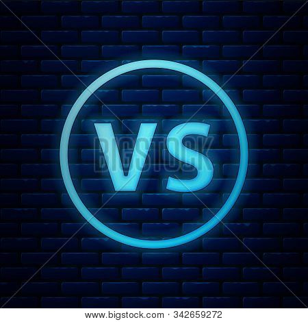 Glowing Neon Vs Versus Battle Icon Isolated On Brick Wall Background. Competition Vs Match Game, Mar