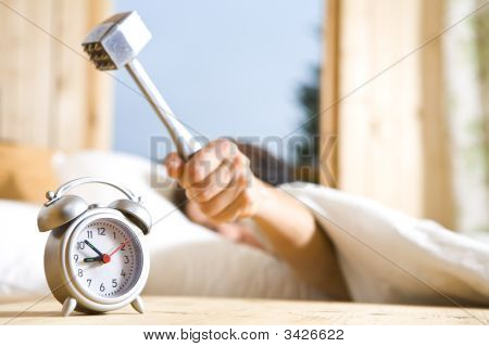 Close up view of big kitchen hammer is ready to crash alarm-clock poster
