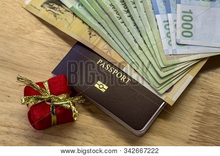Bangkok/thailand-december 27,2019 : People Holding Passports, Money  For Travel With Luggage For The