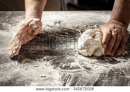 Male Hands Making Dough For Pizza, Dumplings Or Bread. Baking Concept. Chef With Raw Dough.