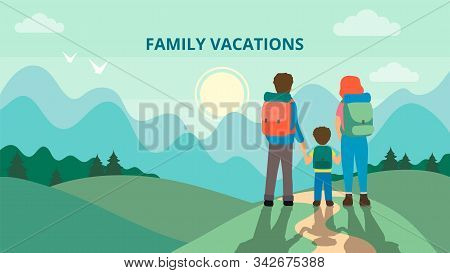 Happy Family Is Hiking In The Mountains. Father, Mother And Children Are Traveling Through The Mount