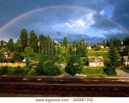 Rainbow Over Carpathian Mountain Village. Picturesque And Magic Carpathian Mountains In Summer. East