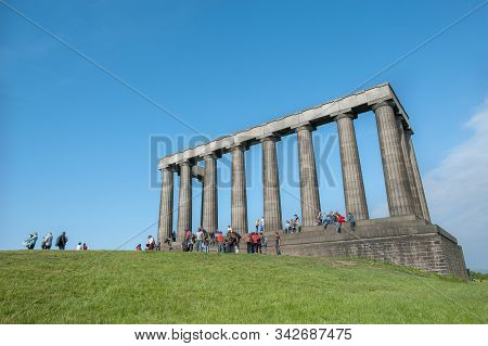 Edinburgh, Scotland - June 18, 2016 - Tourists Gather At The National Monument Of Scotland During Su