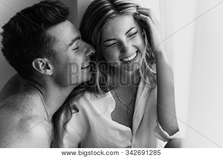 Happy Young Loving Couple Smiling. Young Couple In Love Have Fun I On New Years Eve Or St Valentines