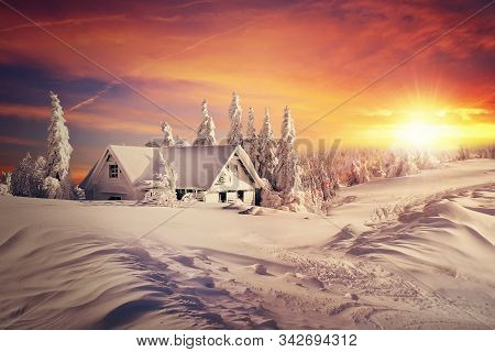 Winter Christmas Sunrise Scene, Raster Art Illustration. Image Of A Country House, Hut In A Snowy Mo