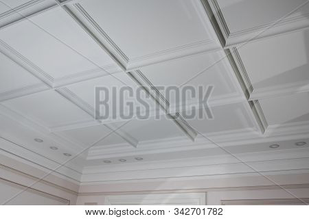 Ceiling Moldings In The Interior, Detail Of A Angular Ceiling Skirting And Lamps