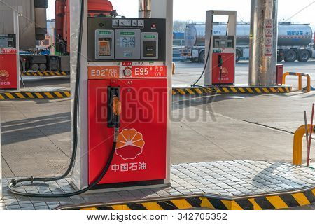 Xian, China - December 29, 2019: Chinese Petrol Station Supplying Gasoline For Refueling A Car With