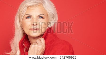Senior Lady In Red Fashionable Clotes.
