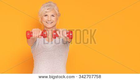 Happy Senior Woman Exercising.
