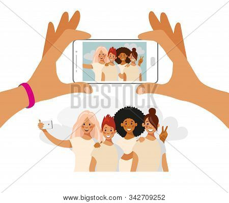 Girls Take Pictures On The Phone. A Group Of Friends Of Different Nationalities Is Photographed. Sel
