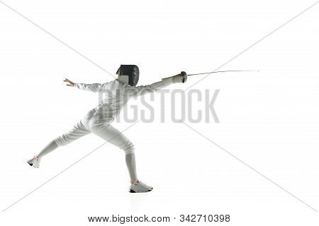 Teen Girls In Fencing Costumes With Swords In Hands Isolated On White Studio Background. Young Femal