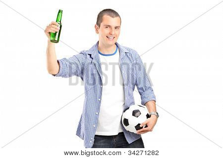 An euphoric male fan holding a football and beer bottle isolated on white background
