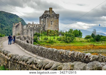 Eilean Donan, Scotland / United Kingdom - July 31, 2016: A Family On Their Way To Visit The Eilean D
