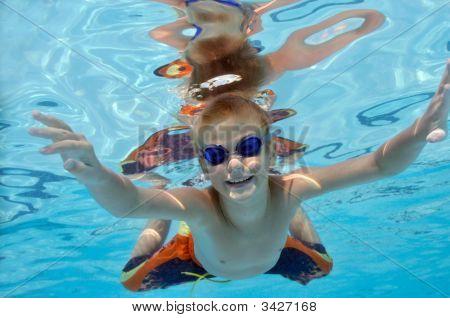Boy Playing In Swimming Pool