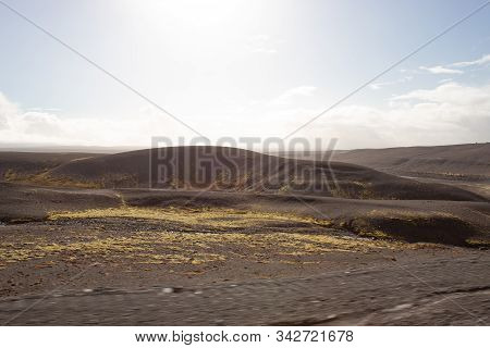 Black Rocks And Mountains In The Distance In Southern Iceland
