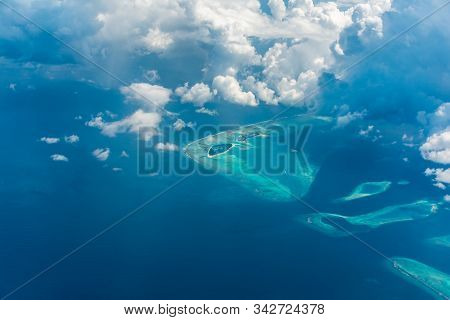 Aerial View Of Maldives Island Beautiful Blue Ocean With Clouds And Atolls Famous Tourist Destinatio