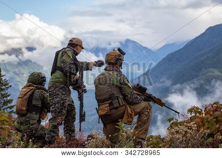 Chilliwack, British Columbia, Canada - October 5, 2019: Army Man Wearing Tactical Uniform And Holdin