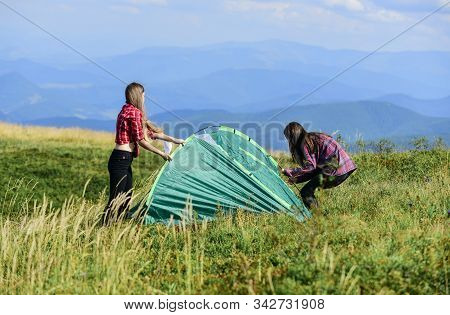 Girls Set Up Tent On Top Mountain. Camping Skills Concept. Camping And Hiking. In Middle Of Nowhere.