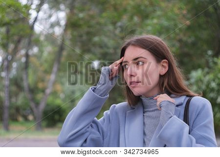 Forgetful Woman Touching Her Head Having Just Realized She Made A Mistake Or Forgot Something. Just