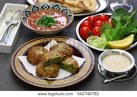 egyptian food (taameya, aish, tahini, ful medames)