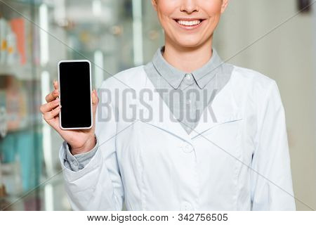 Cropped View Of Smiling Druggist Holding Smartphone With Blank Screen