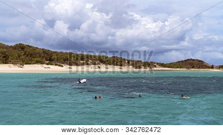 Yeppoon, Queensland, Australia - December 2019: A Rescue Boat Circles Snorkelers Viewing The Underwa