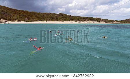 Yeppoon, Queensland, Australia - December 2019: Snorkelers Viewing The Underwater Coral Reef Near Gr
